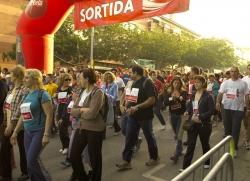 Sortida al carrer del Molí. Després dels esportistes, la resta de participants